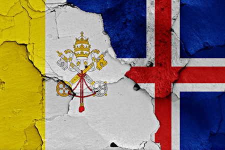 flag of Vatican and Iceland painted on cracked wall Stock Photo