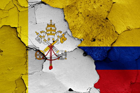 flag of Vatican and Colombia painted on cracked wall