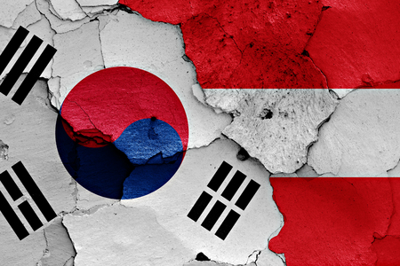 flag of South Korea and Austria painted on cracked wall