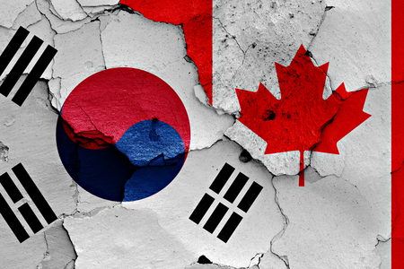 flag of South Korea and Canada painted on cracked wall