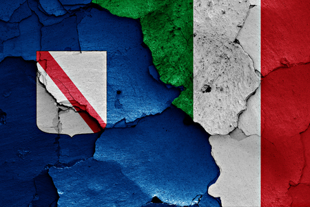 flags of Campania and Italy painted on cracked wall