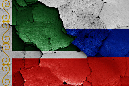 flags of Chechnya and Russia painted on cracked wall