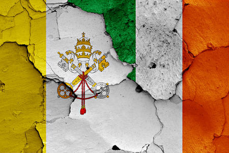 Flags of Vatican and Ireland painted on cracked wall