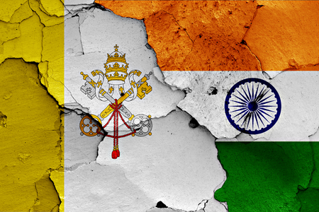 flags of Vatican and India painted on cracked wall Stock Photo