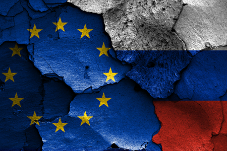 flags of European union and Russia painted on cracked wall Stock Photo