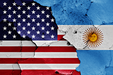 flags of United States and Argentina painted on cracked wall Stock Photo