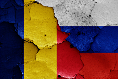 flags of Romania and Russia painted on cracked wall