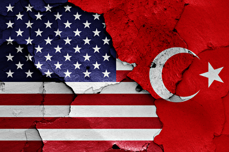 flags of USA and Turkey  painted on cracked wall Foto de archivo