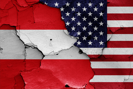flags of Austria and USA painted on cracked wall