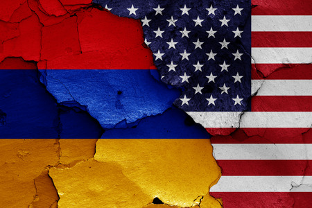 flags of Armenia and USA painted on cracked wall