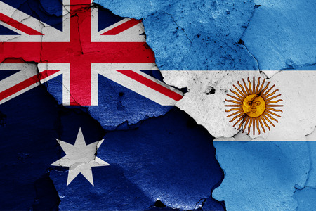 flags of Australia and Argentina painted on cracked wall Stockfoto