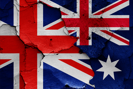 flags of UK and Australia painted on cracked wall