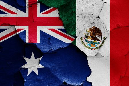 flags of Australia and Mexico painted on cracked wall 版權商用圖片