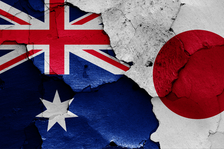 flags of Australia and Japan painted on cracked wall 版權商用圖片