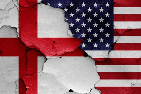 flags of England and USA painted on cracked wall Stock Photo