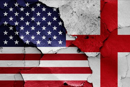flags of USA and England painted on cracked wall