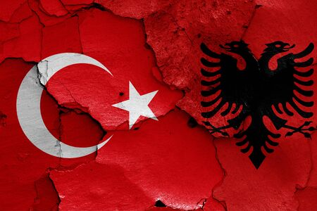 flags of Turkey and Albania painted on cracked wall Stock Photo