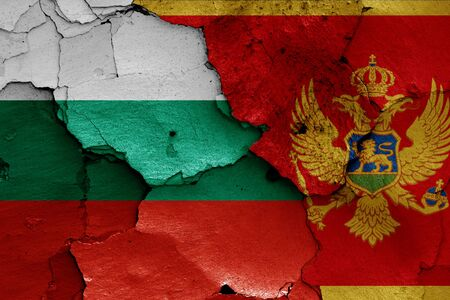 flags of Bulgaria and Montenegro painted on cracked wall