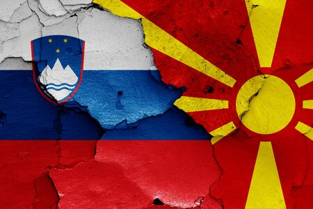 flags of Slovenia and North Macedonia painted on cracked wall Stok Fotoğraf - 131190731