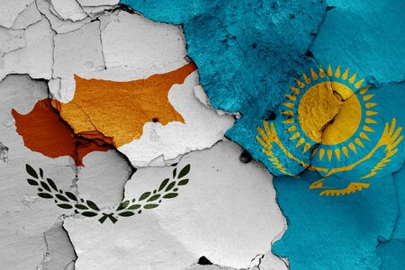 flags of Cyprus and Kazakhstan painted on cracked wall