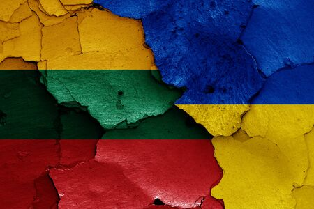 flags of Lithuania and Ukraine painted on cracked wall