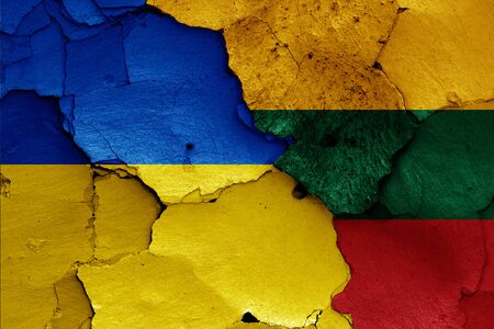 flags of Ukraine and Lithuania  painted on cracked wall Stok Fotoğraf - 131190869