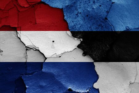 flags of Netherlands and Estonia painted on cracked wall Stok Fotoğraf - 131217546