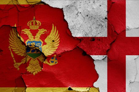 flags of Montenegro and England painted on cracked wall