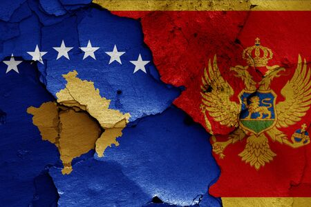 flags of Kosovo and Montenegro painted on cracked wall Stok Fotoğraf