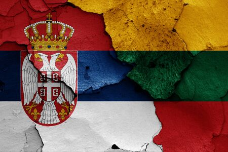 flags of Serbia and Lithuania painted on cracked wall