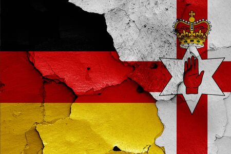 flags of Germany and Northern Ireland painted on cracked wall Stok Fotoğraf