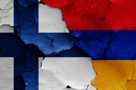 flags of Finland and Armenia painted on cracked wall
