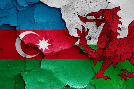 flags of Azerbaijan and Wales painted on cracked wall Stok Fotoğraf - 131217644