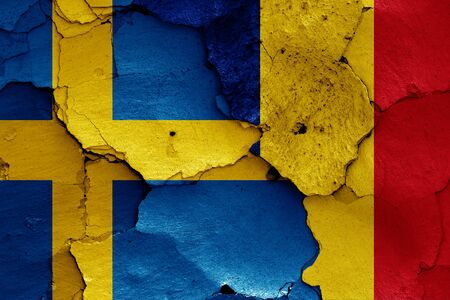 flags of Sweden and Romania painted on cracked wall