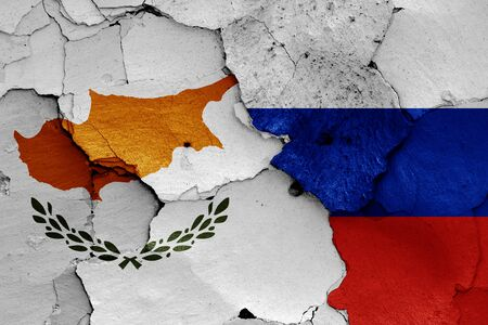 flags of Cyprus and Russia painted on cracked wall Stok Fotoğraf