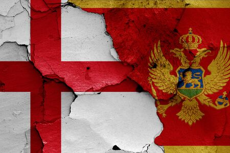 flags of England and Montenegro painted on cracked wall Stok Fotoğraf - 131218714