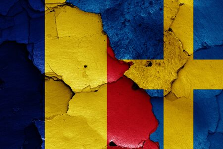 flags of Romania and Sweden painted on cracked wall