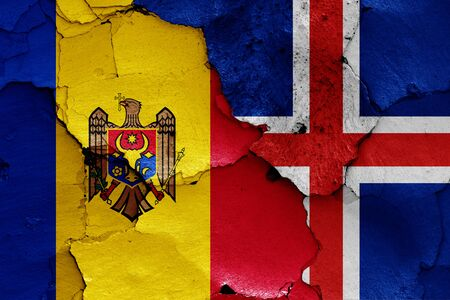 flags of Moldova and Iceland painted on cracked wall