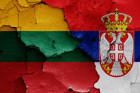 flags of Lithuania and Serbia painted on cracked wall