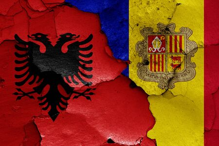 flags of Albania and Andorra painted on cracked wall