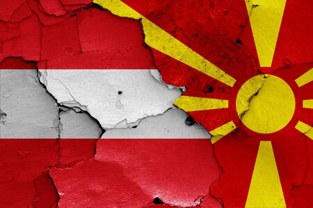 flags of Austria and North Macedonia painted on cracked wall