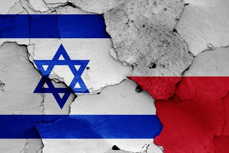 flags of Israel and Poland painted on cracked wall