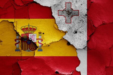 flags of Spain and Malta painted on cracked wall Stok Fotoğraf