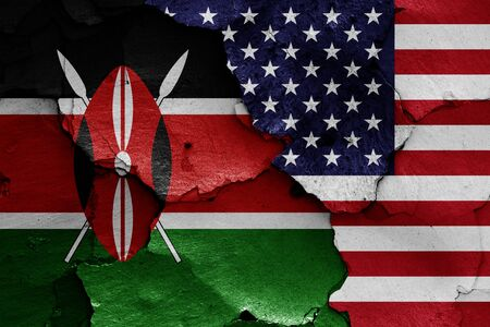 flags of Kenya and USA painted on cracked wall
