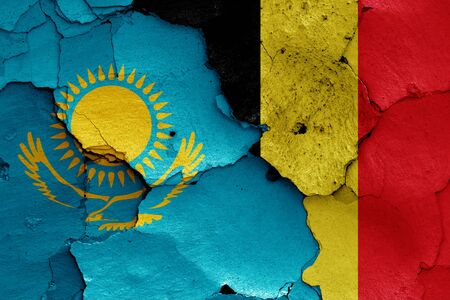 flags of Kazakhstan and Belgium painted on cracked wall