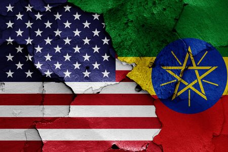 flags of USA and Ethiopia painted on cracked wall Stok Fotoğraf - 131217521