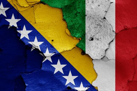 flags of Bosnia and Herzegovina and Italy painted on cracked wall Stok Fotoğraf