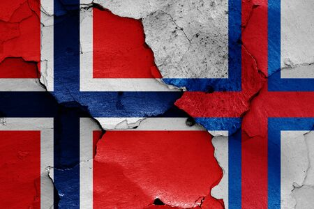 flags of Norway and Faroe Islands painted on cracked wall Stok Fotoğraf