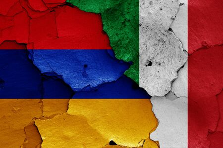 flags of Armenia and Italy painted on cracked wall