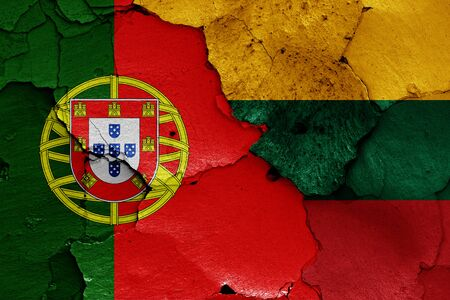 flags of Portugal and Lithuania painted on cracked wall